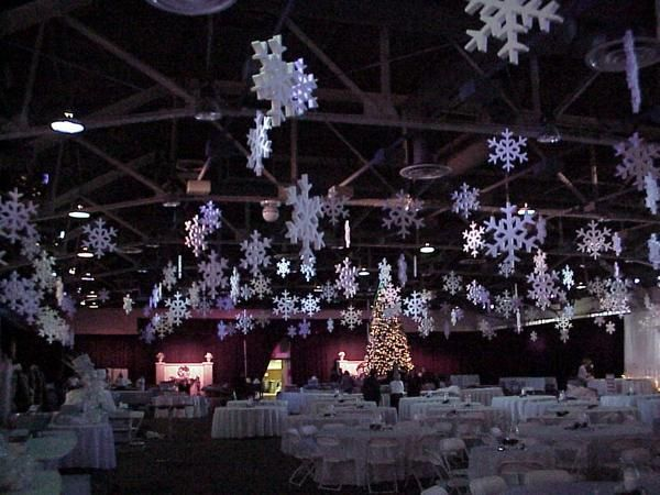 foam snowflakes hanging from the ceiling in a large room